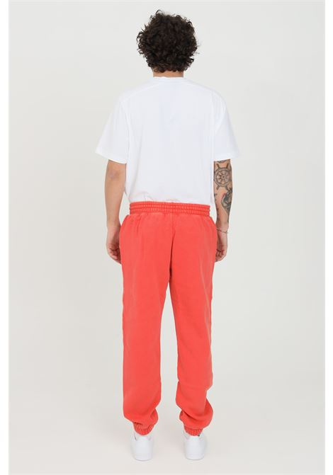 Pantaloni uomo arancio adidas dyed tinta unita ADIDAS | Pantaloni | HB8050.