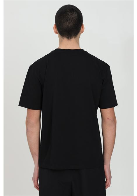 Black t-shirt with short sleeves and print on the front. Basic model with round neck.Straight bottom.Bhmg BHMG | T-shirt | 028326110