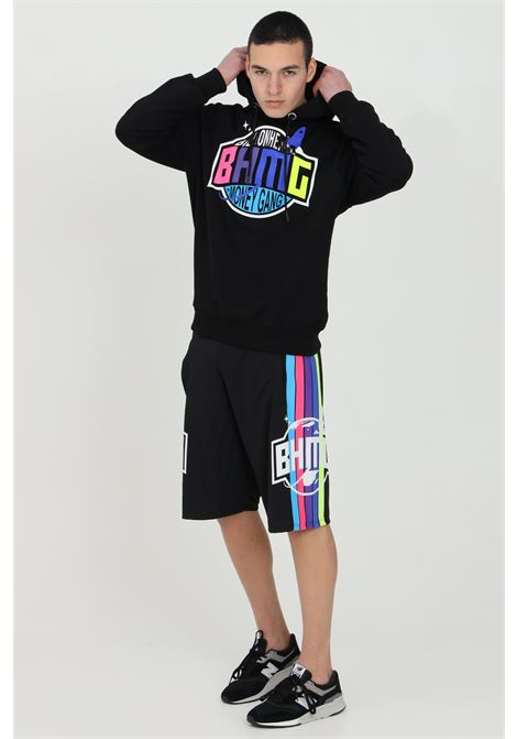 Black casual shorts with side print.Elastic waistband with multicolor bands on the sides. Side pockets and straight bottom.Bhmg