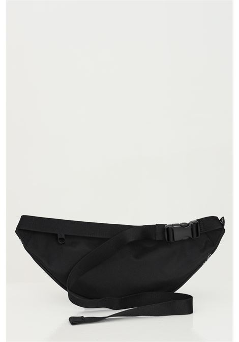Black pouch in recycled polyester, solid color with lettering print in contrast. Calvin klein CALVIN KLEIN | Pouch | K50K50688801A
