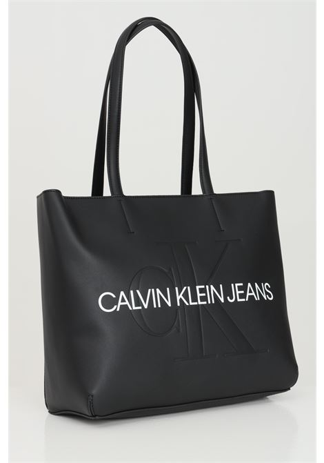 Black shopper in solid color with logo lettering in contrast. Exterior in eco-leather and non adjustable shoulder straps. Zip and snap button closure. Calvin klein CALVIN KLEIN   Bag   K60K607464BDS