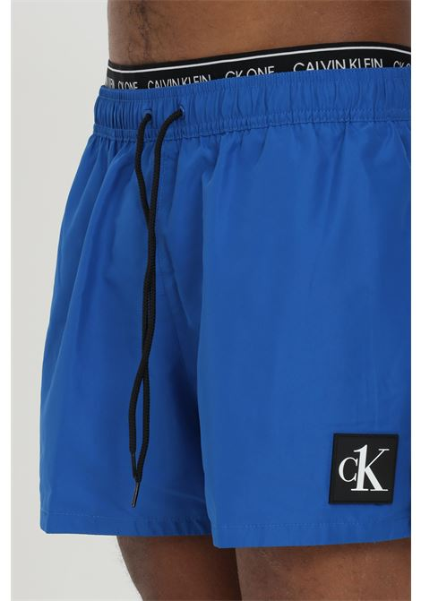 Swimsuit shorts with logo band CALVIN KLEIN | Beachwear | KM0KM00568C5D