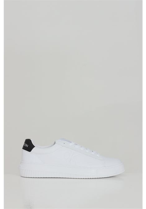 Sneakers in solid color and tone-on-tone logo CALVIN KLEIN | Sneakers | YM0YM00036YAF