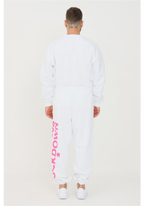 White unisex trousers by comme des fuckdown with fluo print COMME DES FUCKDOWN | Pants | CDFU1109BIANCO
