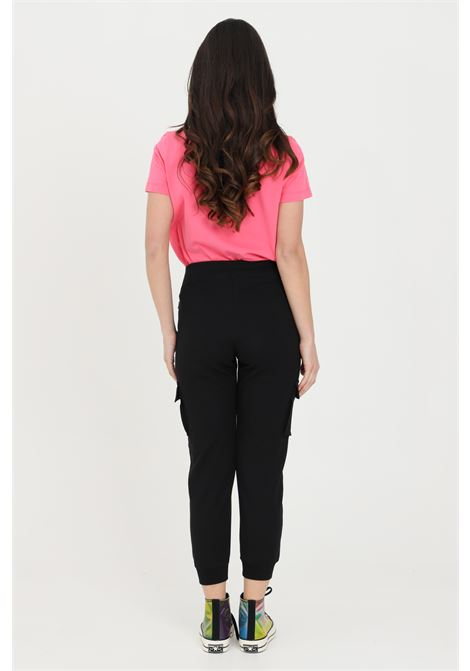 Black trousers with side pockets, elastic waistband and cuffs. Mini side logo. Converse CONVERSE | Pants | 10022601-A02A02