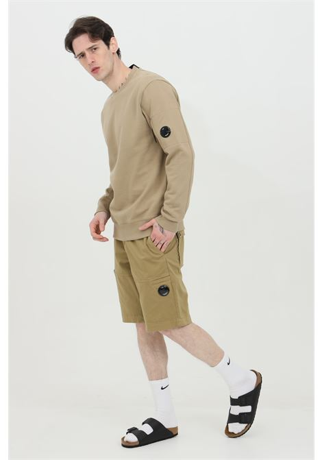 Beige shorts with medium waist, zip and button closure. C.p. company C.P. COMPANY | Shorts | 10CMBE115A-005694G329