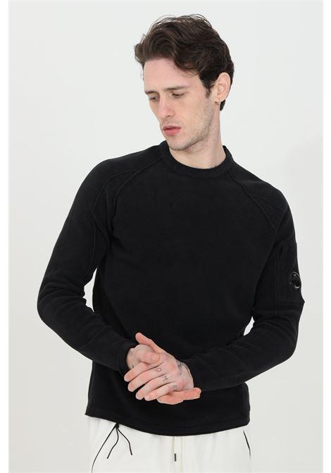Black sweatshirt with crew neck. C.p. company  C.P. COMPANY | Knitwear | 10CMKN264A-005687G999
