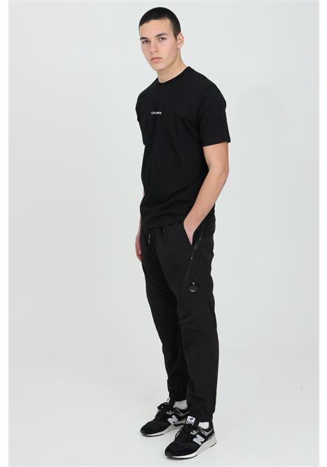 Black pants with side pockets and elastic waistband. C.p. company C.P. COMPANY | Pants | 10CMPA051A-005904G999