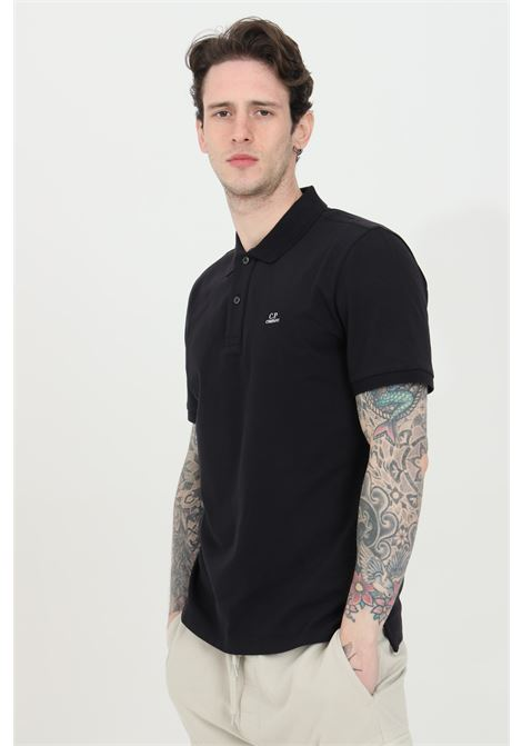Black polo shirt with buttons and contrasting logo, short sleeves. Slim model. C.p. company C.P. COMPANY | Polo Shirt | 10CMPL067A-005263W999