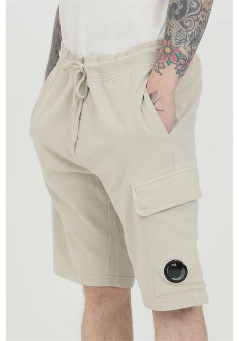 Beige with elasticated adjustable waistband. Side pockets with buttons. Comfortable model. C.p. company C.P. COMPANY | Shorts | 10CMSB041A-002246G906