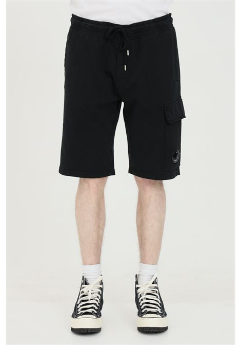 Black with elasticated adjustable waistband. Side pockets with buttons. Comfortable model. C.p. company C.P. COMPANY | Shorts | 10CMSB041A-002246G999
