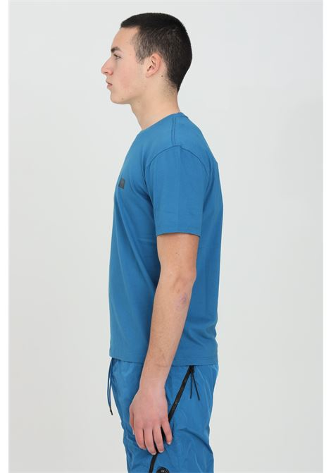 Blue t-shirt with front logo, short sleeves. Slim fit model. C.p. company C.P. COMPANY | T-shirt | 10CMTS063A-005100W870