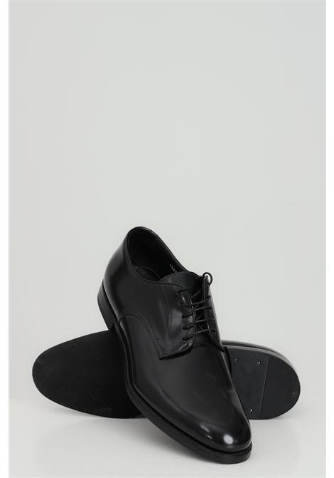 Black shoes. Brand: Doucal's  DOUCAL'S | Party Shoes | DU1003MONZUF028NN00