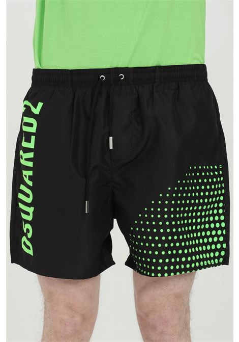 Black swimsuit shorts with elastic waistband and fluo print on the back. Closure with laces and inner mesh lining. Dsquared2 DSQUARED2 | Beachwear | D7B543710964