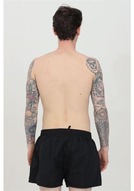 Beachwear costume uomo nero dsquared2 shorts mare con logo laterale giallo. Chiusura con lacci. Modello comodo DSQUARED2 | Beachwear | D7B642920014