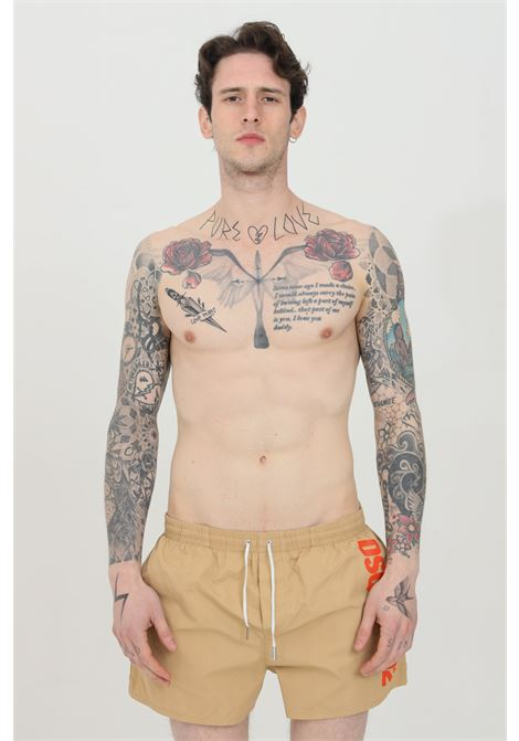 Beige swimsuit shorts with orange logo on the side. Closure with laces. Comfortable model. Dsquared2  DSQUARED2   Beachwear   D7B642920283