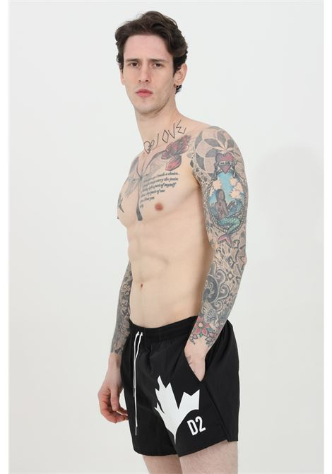 Black swimsuit shorts with elastic waistband and leaf print on th front. Dsquared2 DSQUARED2   Beachwear   D7B643640001