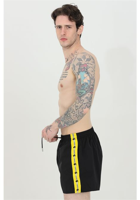 Black swimsuit shorts with yellow band. Closure with laces. Comfortable model, straight bottom. Dsquared2  DSQUARED2 | Beachwear | D7B643660001