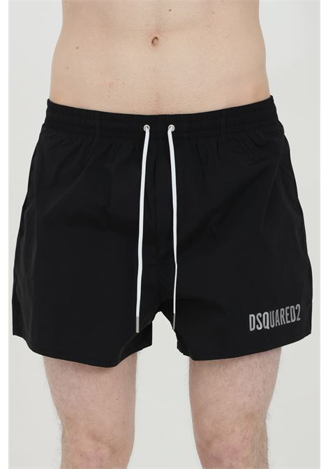 Black swimsuit shorts with elastic waistband and Icon print on the back. Closure with laces and inner mesh lining. Dsquared2  DSQUARED2 | Beachwear | D7B643730008