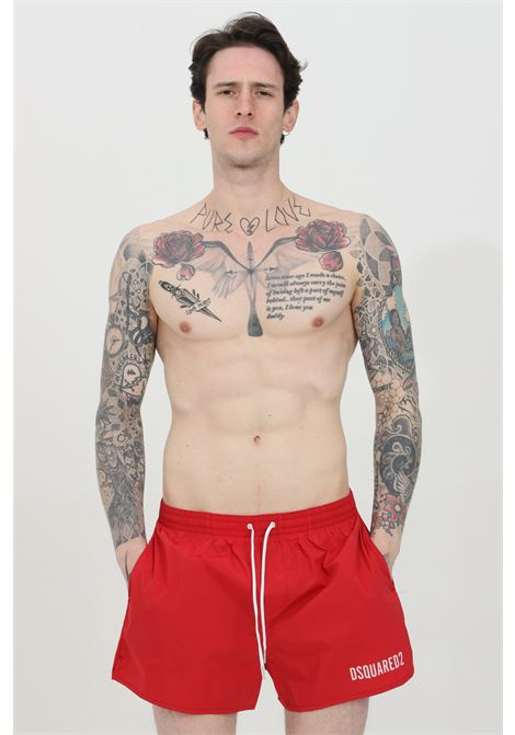 Red swimsuit shorts with elastic waistband and Icon print on the back. Closure with laces and inner mesh lining. Dsquared2  DSQUARED2   Beachwear   D7B643730618