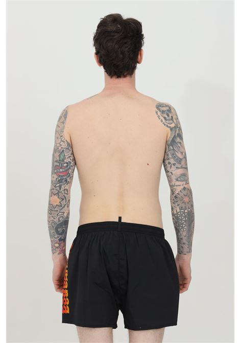 Black swimsuit shorts with side logo print. Closure with laces. Comfortable model, straight bottom. Dsquared2 DSQUARED2   Beachwear   D7B8P3790018