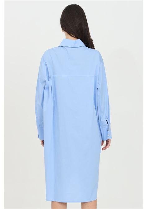 Light blue shirt with front buttons and side slit. Regular collar and long sleeves. Over size model. Kontatto KONTATTO | Shirt | MU300165