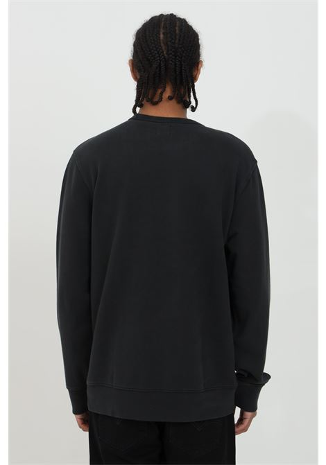 Black crew neck sweatshirt in solid color with front print. Ribbed cuffs and bottom. Comfortable model. Levi's   LEVI'S | Sweatshirt | 17895-01110111