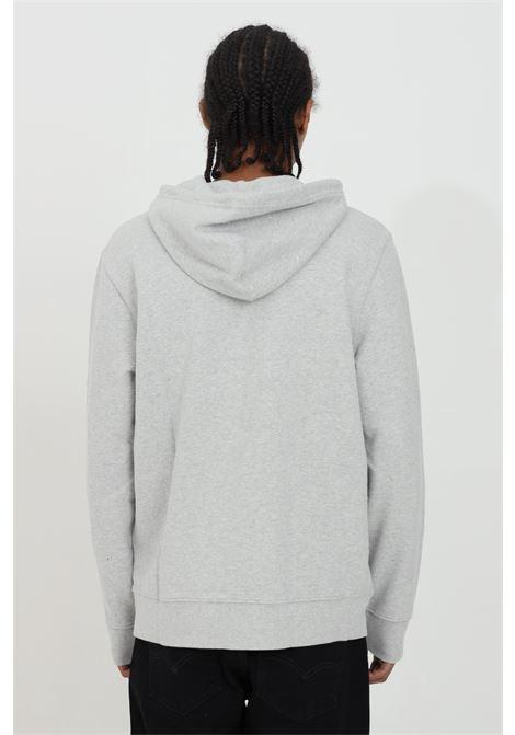 Felpa uomo grigio levi's con cappuccio e lacci, tinta unita con logo a contrasto, fondo e polsini elastici. Modello comodo LEVI'S | Felpe | 34581-00000000