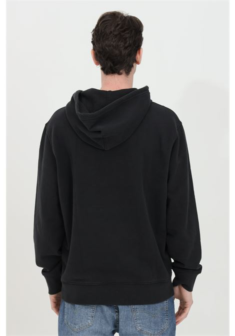 Black hoodie with lace, solid color with contrasting front logo, elastic bottom and cuffs. Comfortable model. Levi's LEVI'S | Sweatshirt | 34581-00010001