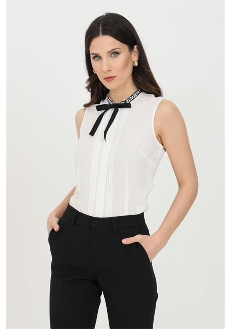 White shirt with bow and rhinestone, concealed front closure with buttons. Romantic design without sleeves. Liu jo LIU JO | Shirt | WA1014T912110701