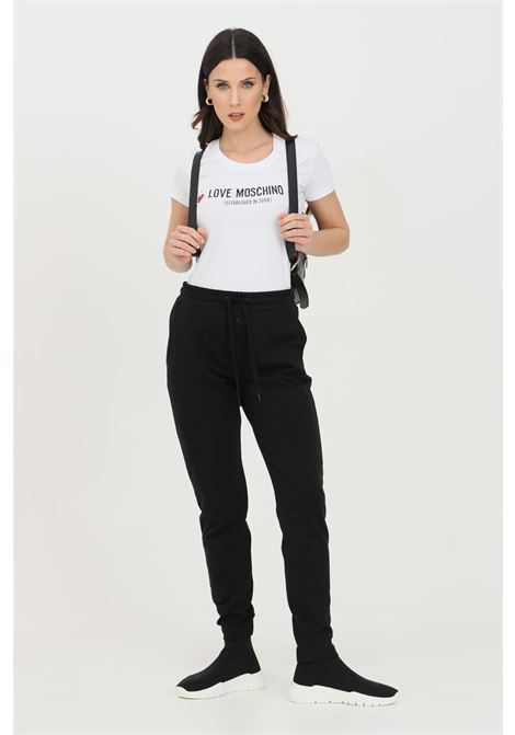 Black pants in solid color with logo on the back, spring at the waist and side pockets. Love moschino LOVE MOSCHINO   Pants   W151303E2180C74