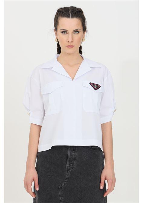 White shirt in solid color with front pockets and logo patch, button closure, short sleeve model. Maison 9 paris MAISON 9 PARIS | Shirt | M9C694BIANCO