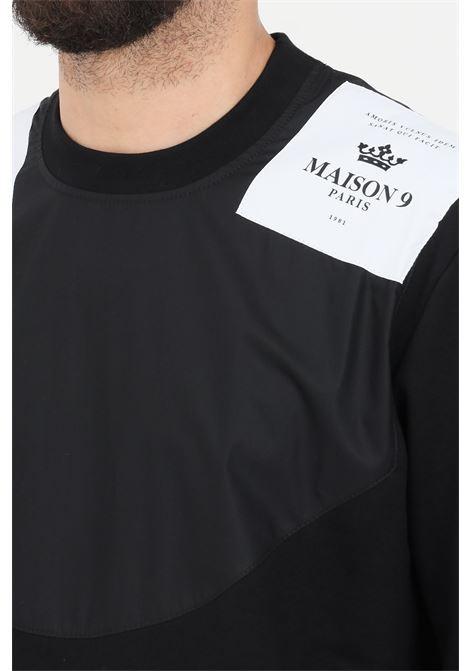 Black crew neck sweatshirt with logo patch. Maison 9 paris  MAISON 9 PARIS | Sweatshirt | M9F2111NERO
