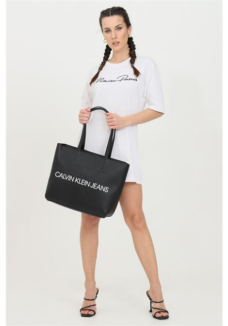 White dress, front logo with glitter applications. Comfortable model. Maison 9 paris MAISON 9 PARIS | Dress | M9M4159BIANCO-NERO