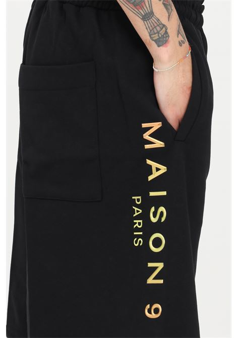 Black casual shorts with side logo print. Maison 9 paris MAISON 9 PARIS | Shorts | M9S5088NERO-BRONZO