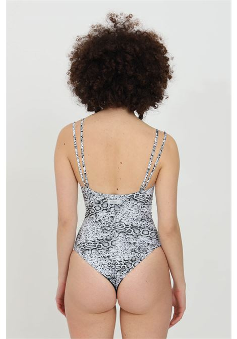 Python one piece swimsuit with allover print and double brace. Open back, slim fit. Matinee  MATINèE | Beachwear | CB2055PITONE