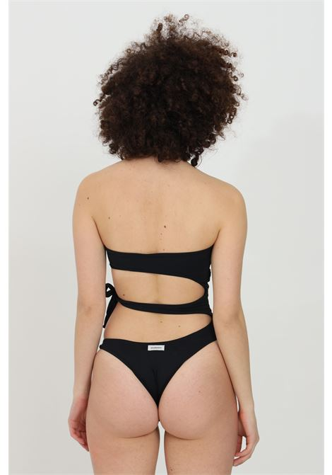 Black one piece swimsuit with central carvings. Side closure. Bandeau top and open back. Matinee MATINèE | Beachwear | EM2094NERO