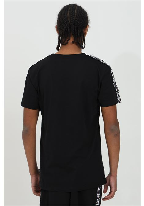 Black t-shirt with front logo and bands on the shoulders, short sleeves. Moschino MOSCHINO | T-shirt | A192681310555