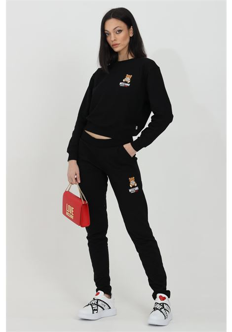 Black pants in solid color with elastic waistband and bear logo on the side. Moschino MOSCHINO | Pants | A432990200555