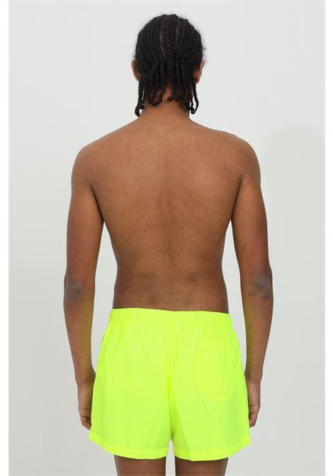 Pantaloncino mare fluo con molla in vita e logo lettering multicolor MOSCHINO | Beachwear | A610823020026