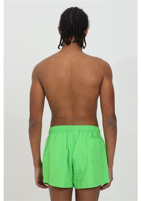 Pantaloncino mare fluo con molla in vita e logo lettering multicolor MOSCHINO | Beachwear | A610823020398