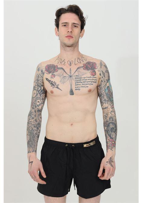 Shorts mare con logo lettering in metallo color oro MOSCHINO | Beachwear | A611954390555