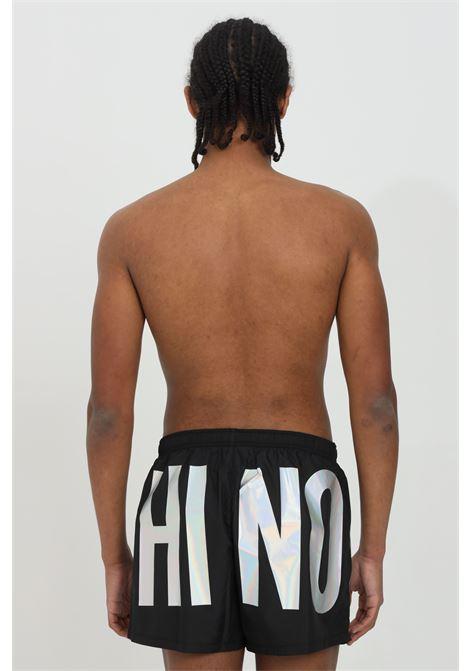 Pantaloncini con stampa lettering olografiche MOSCHINO | Beachwear | A612259890555