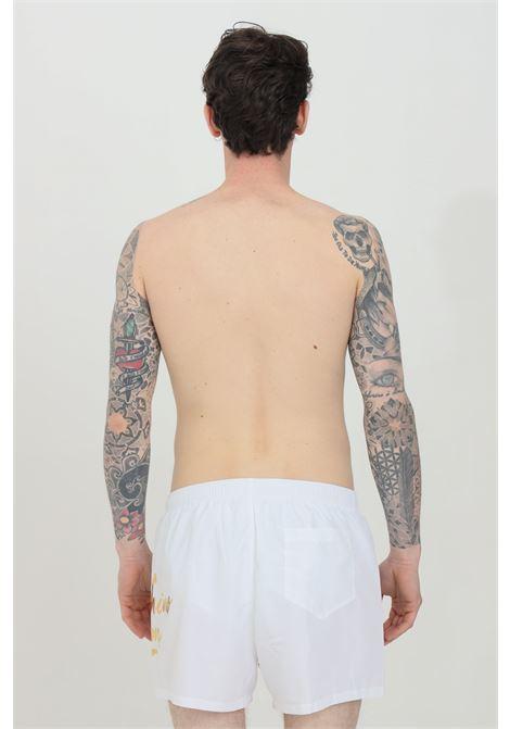 Shorts mare con stampa logo laterale oro MOSCHINO | Beachwear | A615859890001
