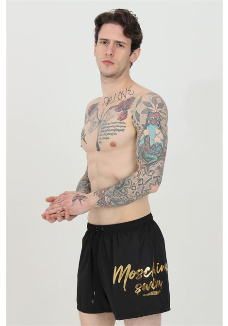 Shorts mare con stampa logo laterale oro MOSCHINO | Beachwear | A615859890555