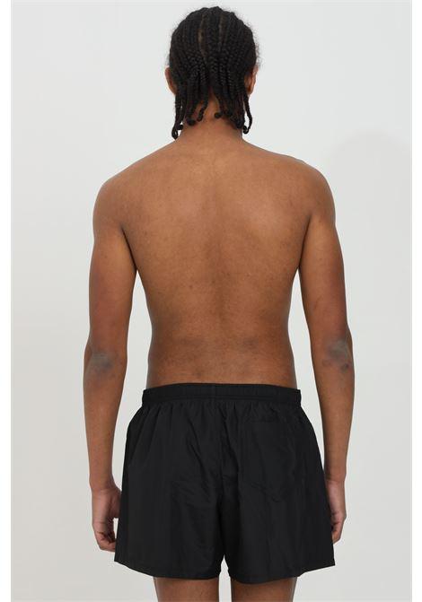 Pantaloncini da mare con stampa flower laterale MOSCHINO | Beachwear | A615959890555