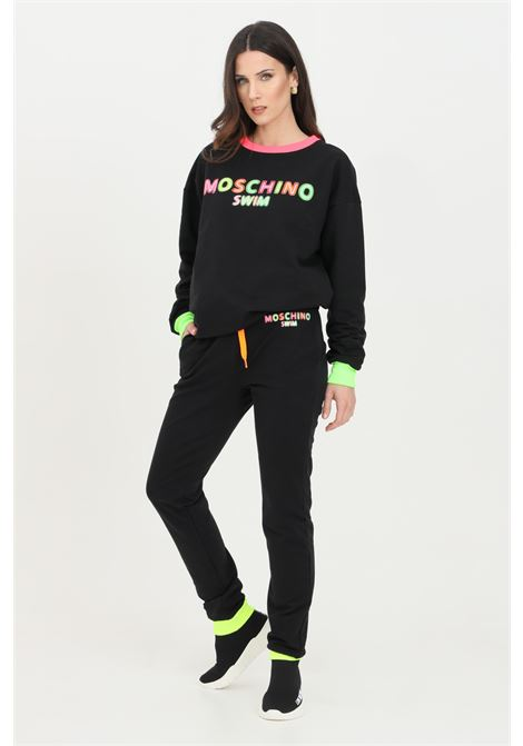 Black pants with elastic waistband. Multicolor front logo, elastic hems with ribs. Side pockets. Moschino MOSCHINO | Pants | A670121170555