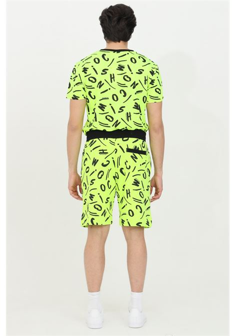 Shorts fluo con stampa allover pattern MOSCHINO | Shorts | A671423391026