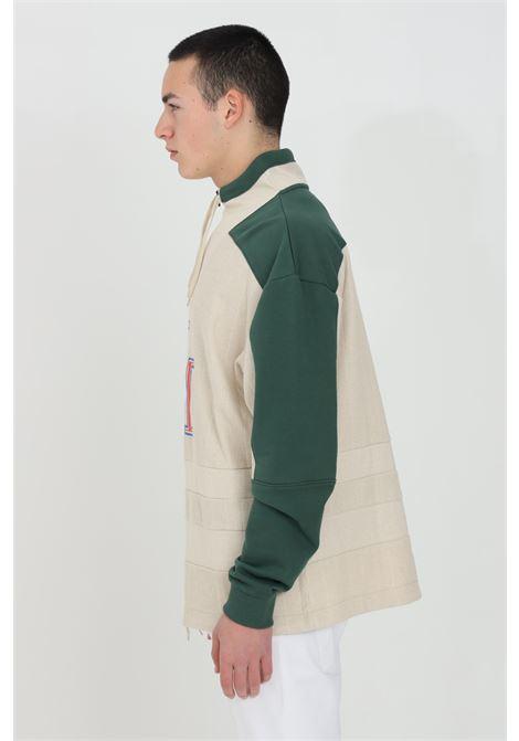 Felpa uomo beige-verde napapijri con mezza zip e lacci con coulisse. Patch color-block e logo ricamato frontale. Vestibilità over, trama a costine NAPAPIJRI BY MARTINE ROSE | Felpe | NP0A4FGXNR2