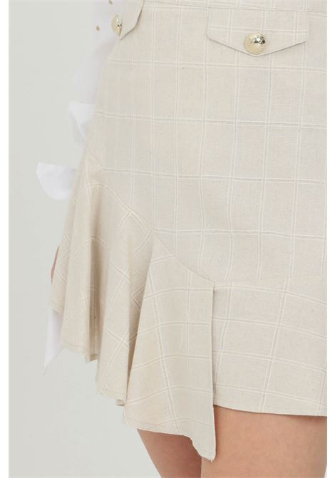 Gonna donna beige nbts corta con false tasche frontali e applicazioni oro, chiusura laterale con zip NBTS | Gonne | NB21096.